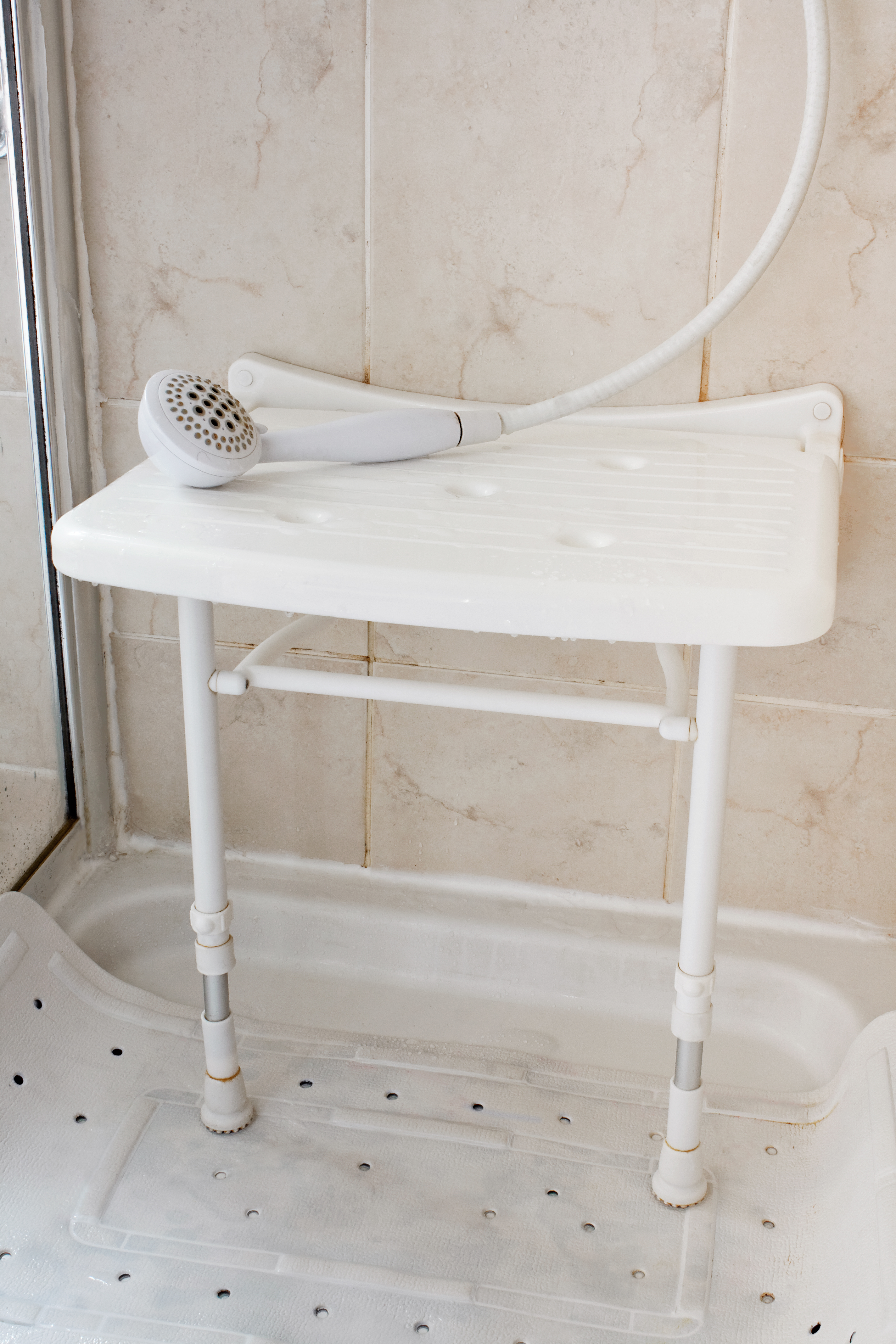 a plastic shower seat will allow you to sit down while you wash